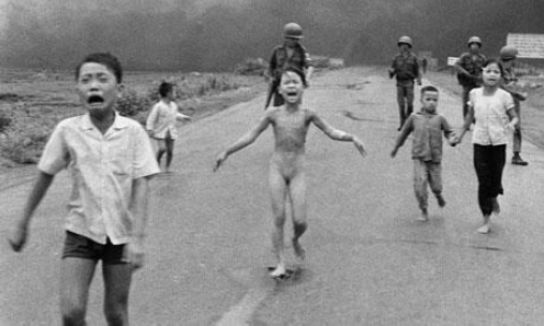 children running from soldiers